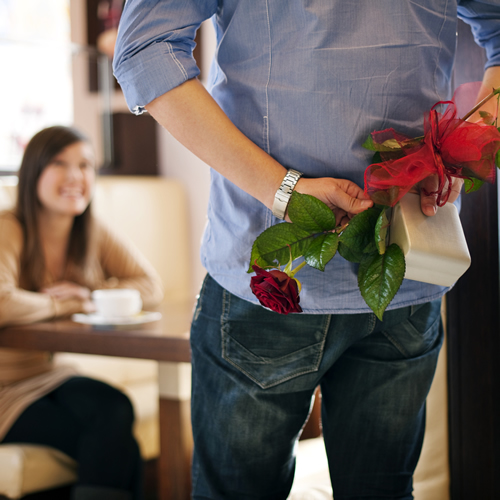 man-hiding-gift-and-flowers-for-woman_500x500