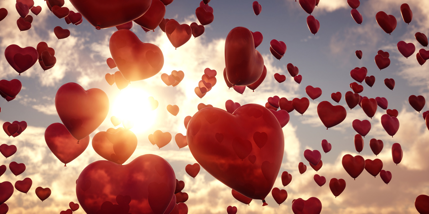 red-heart-balloons-flying-in-the-sky