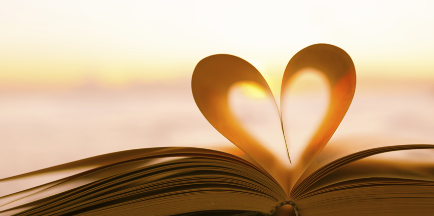 two-sheets-in-book-forming-a-glowing-heart